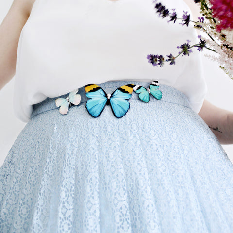 Butterfly brooch worn on a skirt.