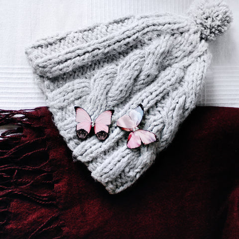 Butterfly Brooches Pinned to a Bobble Hat.