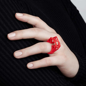 Coral red big statement ring with woman.