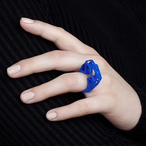 Royal blue big statement ring on finger.
