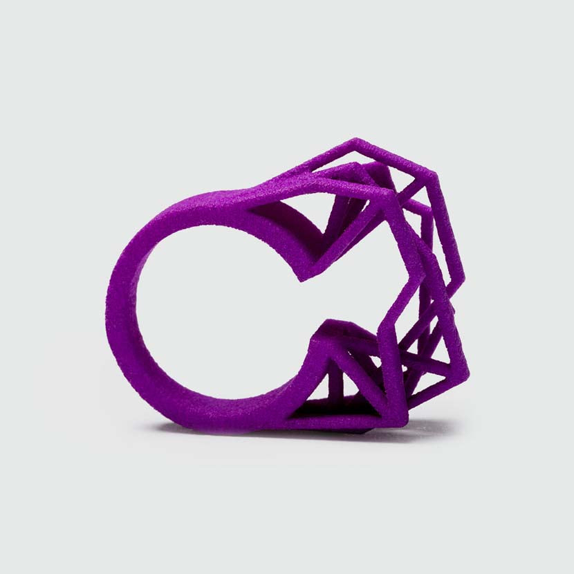 Purple big statement ring.