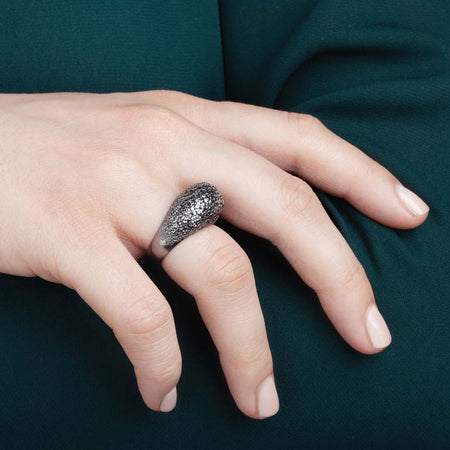 Black crystal ring in wearing scene.