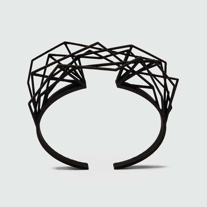 Black cuff bracelet made of nylon.