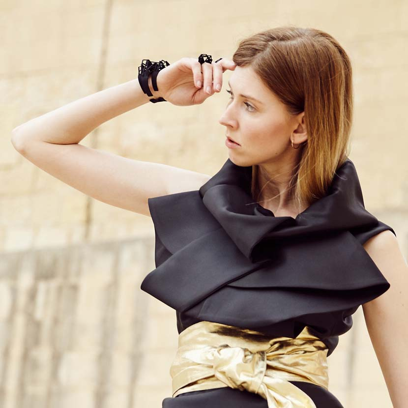 Two black cuff bracelets and black ring on hand during Malta Fashion week.