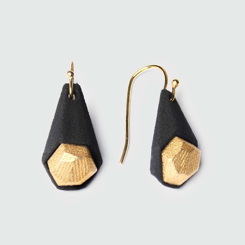 Black drop earrings with gold stones.