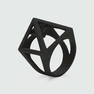 Black pyramid ring made of 3D printed nylon.
