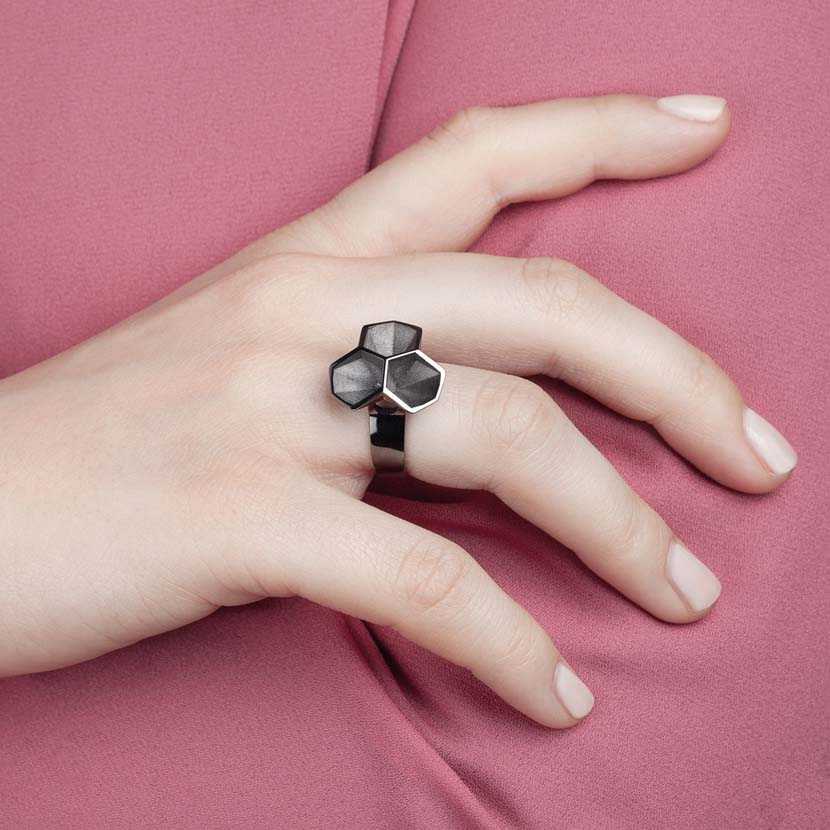 Black statement ring on finder of a hand model.