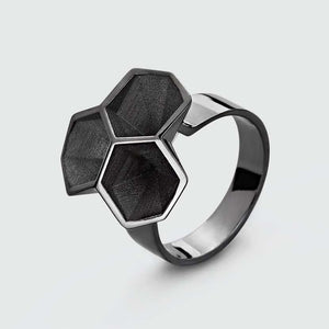 Black statement ring made of silver and black rhodium.