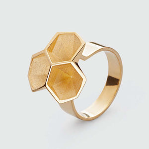 Calyx ring in gold plated brass.
