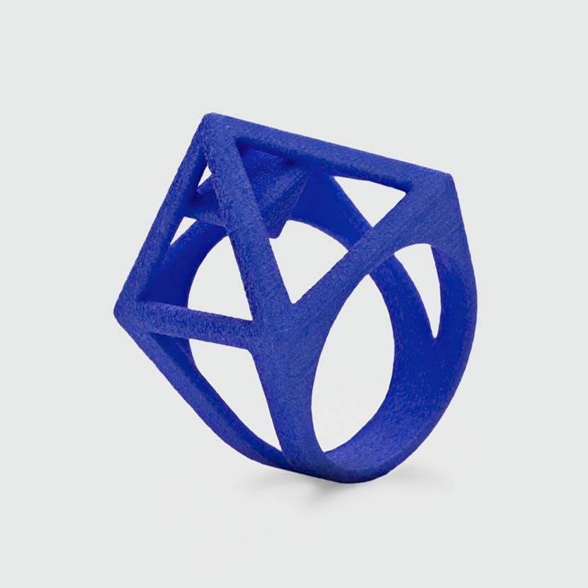 Designer ring with a blue pyramid.