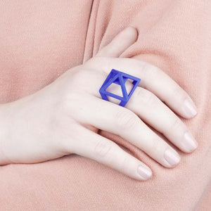 Designer ring shown by model.