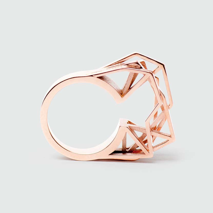 Geometric engagement ring in rose gold side view.