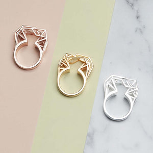 Geometric engagement rings in gold, rose gold and silver.
