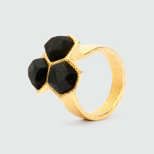 Geometric ring gold black mixed.