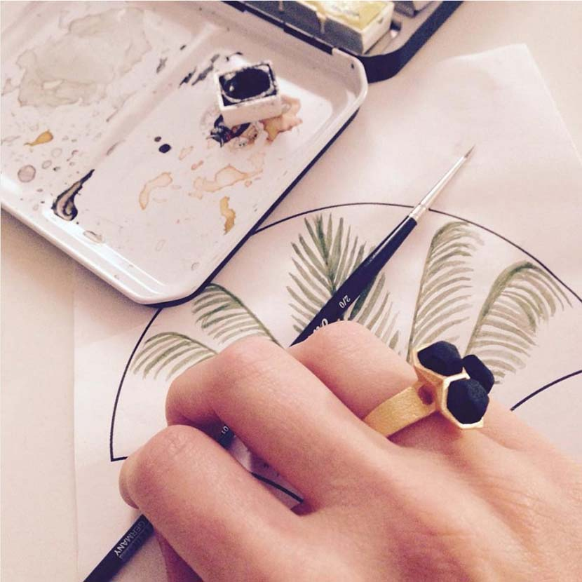 Geometric ring gold black with watercolor painting.