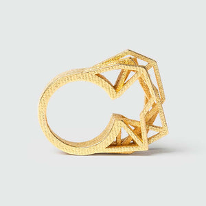 Geometric ring in gold.