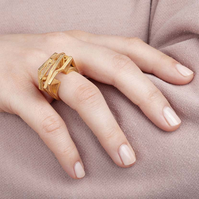 Geometric ring combined with rose jumper.