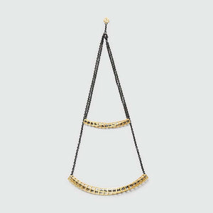Gold double necklace with black chain.
