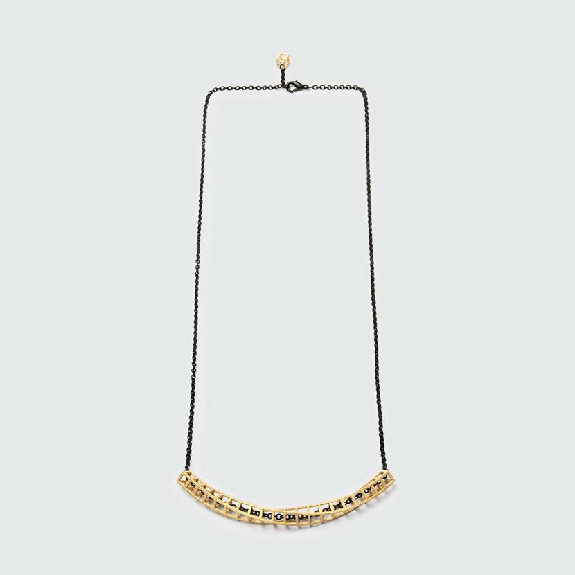 Gold geometric necklace of Cubetwist collection.