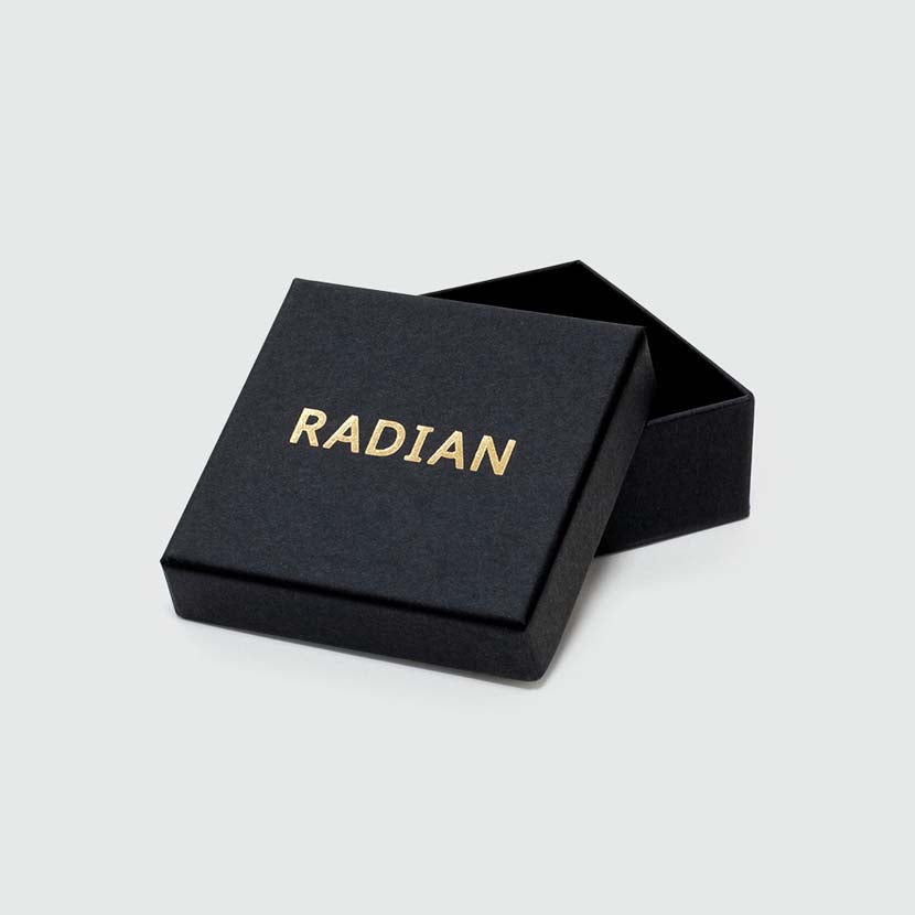 Plain black box with logo for gold architectural earrings.