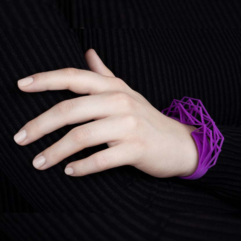 Large cuff bracelet with ultra violet color and abstract shape.