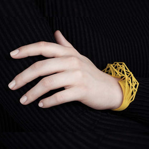Large cuff bracelet with canary yellow color.