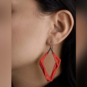 Red lightweight statement earrings with abstract shape.
