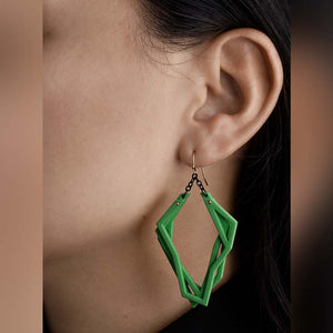 Saturated green lightweight statement earrings.