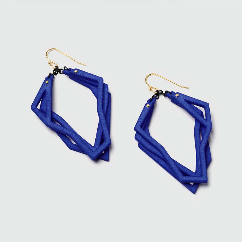 Lightweight statement earrings with royal blue color.