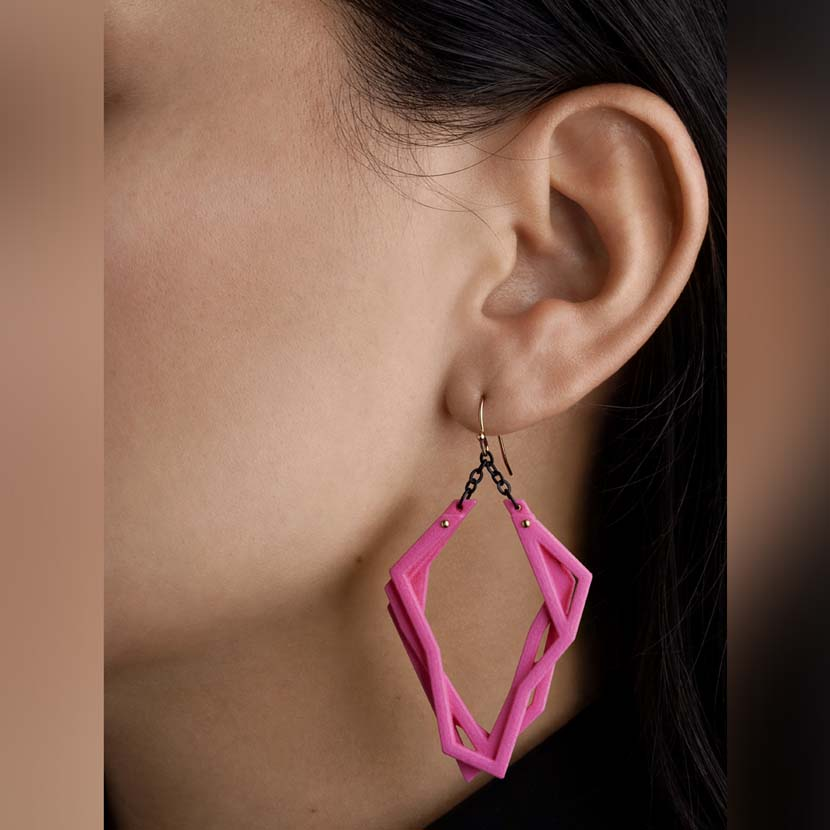 Lightweight statement earrings with pink 3d print.