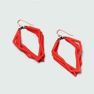 Lightweight statement earrings in coral red.
