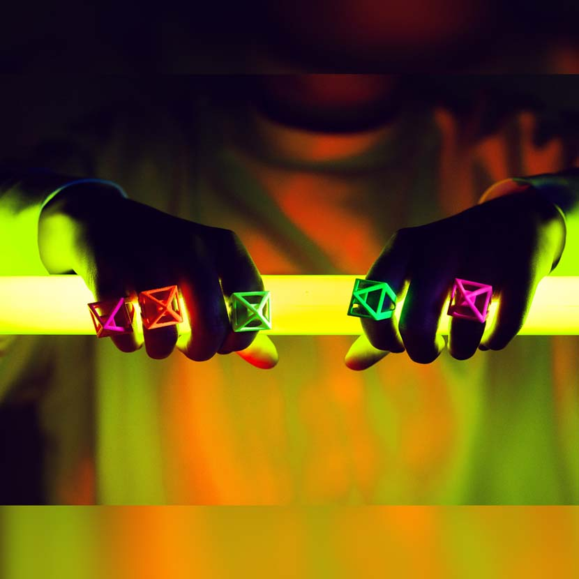 Neon jewelry in action on girl holding light tube.