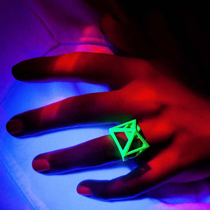 Neon jewelry is shown by hand model.