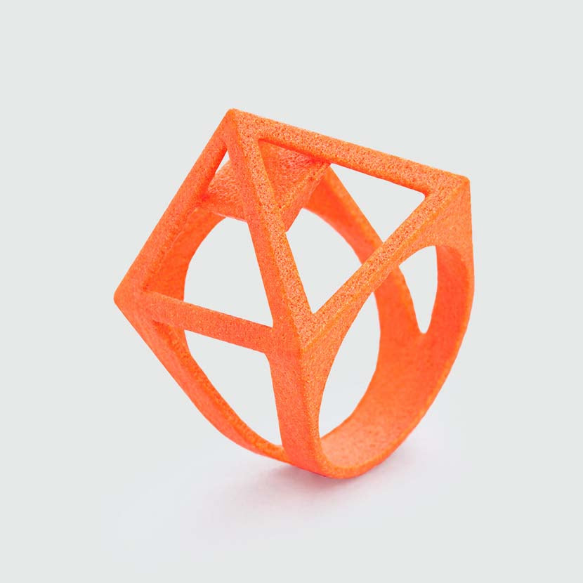 Neon orange jewelry looks like a pyramid.