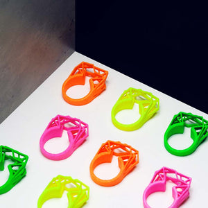 Neon orange ring arranged with more colors.