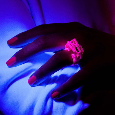 Intense neon pink ring under black light.