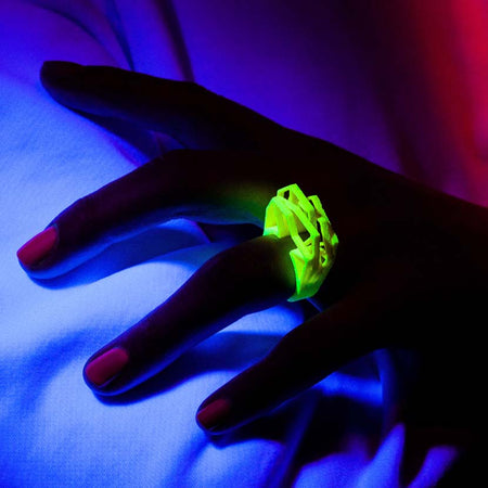 Modern neon yellow ring in use under black light.