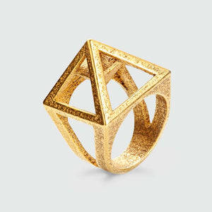 Pyramid ring with secret chamber in gold.