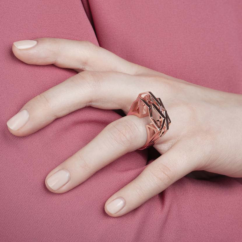 Rose gold statement ring put on finger.
