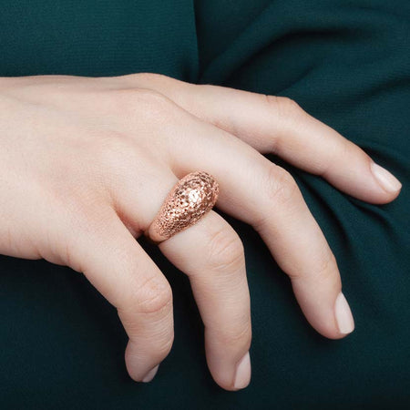 Rosegold crystal ring on model's finger.