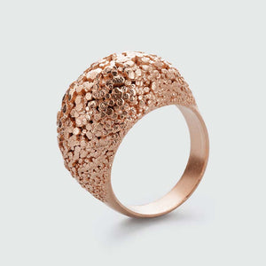 Rosegold crystal ring with surface structure.