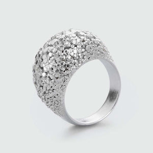 Silver dome ring with uncountable facets.
