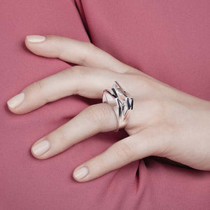 Silver geometric ring on hand model.