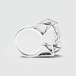 Silver geometric ring with shiny facets.