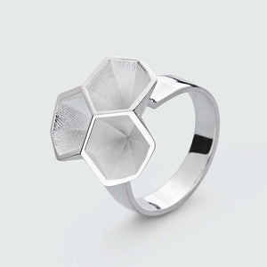 Silver honeycomb ring in full view.