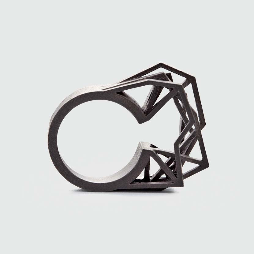 Statement ring titanium with edgy appearance.