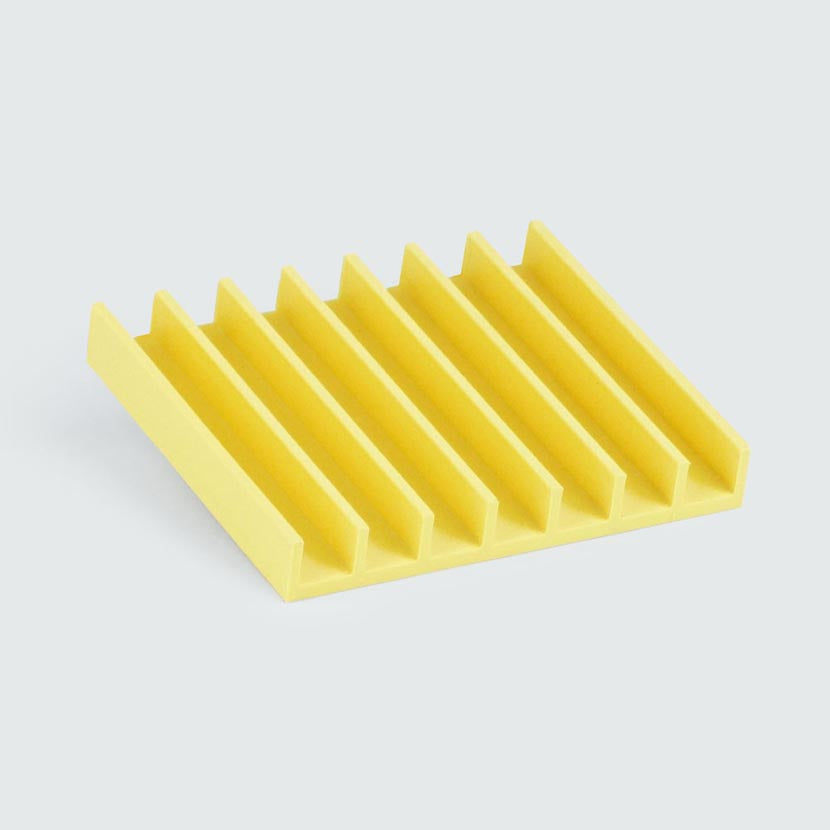 Upcycled home decor soap drain in yellow is 3D printed.