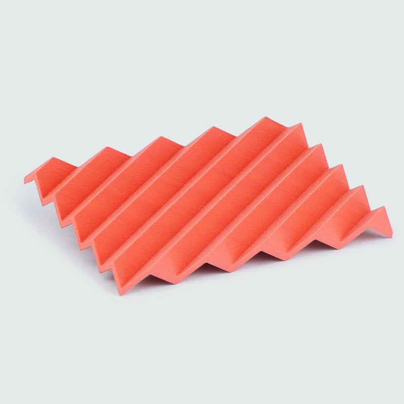 Zigzag soap dish in red colored plastic.