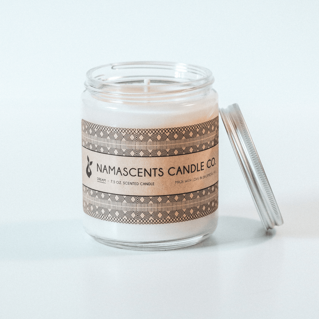 DREAM SCENTED SOY CANDLE sits on white background