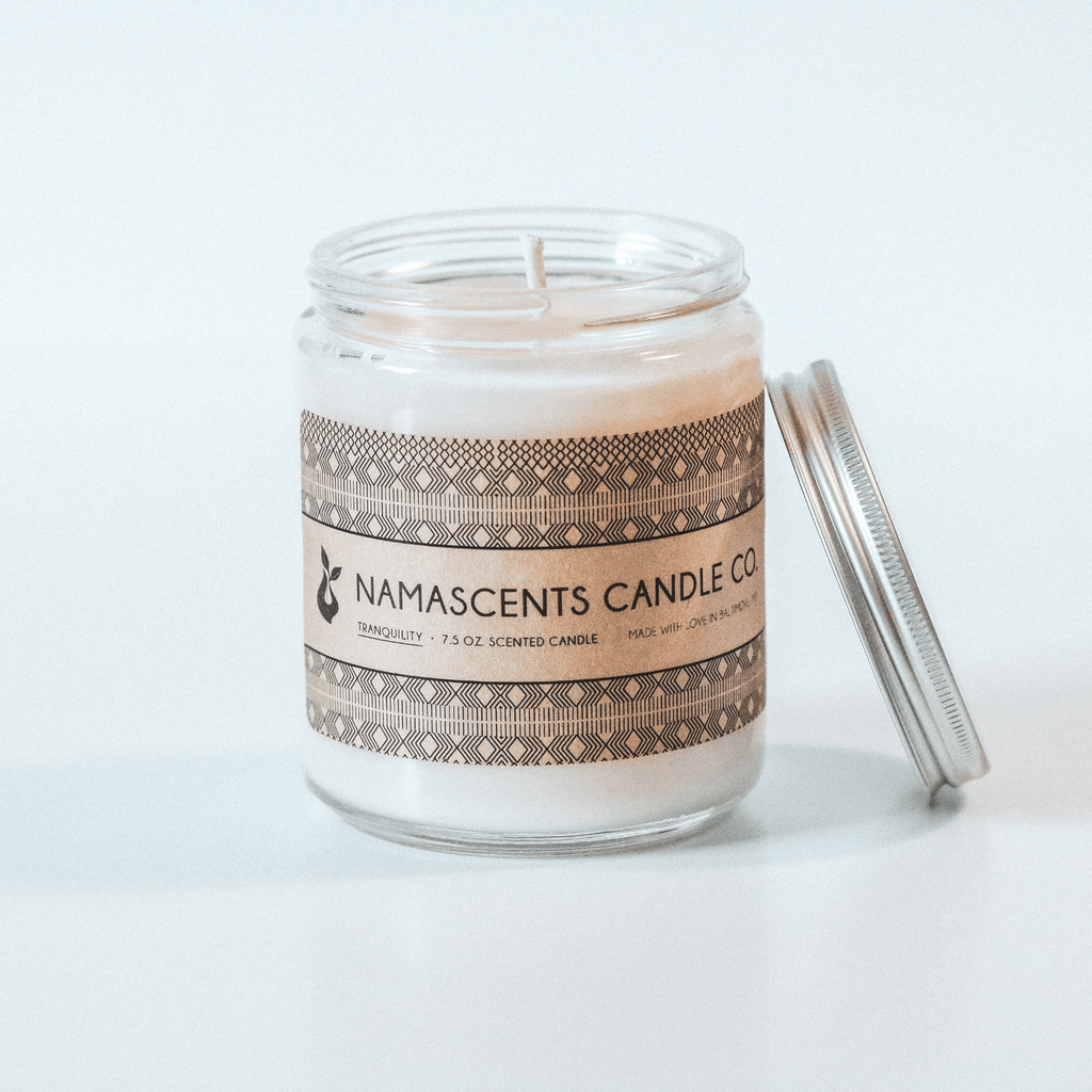 TRANQUILITY SCENTED SOY CANDLE sits on white background